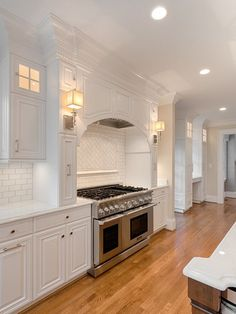 Viking range, herringbone tile, white cabinets in the kitchen.