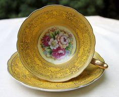Antique cup and saucer. Hand painted in by AnythingDiscovered, $48.00
