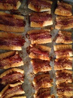 Yumm!!! Bacon-wrapped crackers!      Take club crackers. Wrap 1/3 piece of bacon (stretched and folded in half) end to end longways around each cracker and place on a baking sheet with sides. Sprinkle the wrapped crackers with Parmesan cheese and hot sauce. Bake in a 250 degree oven for 2 hours or until the bacon is crisp. Enjoy!