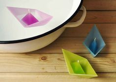 adorable origami boat candles are self-contained and float beautifully in water. These adorable origami boat candles are self-contained and float beautifully in water.