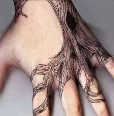 Tree hand tattoo. Love the roots and the hollow.