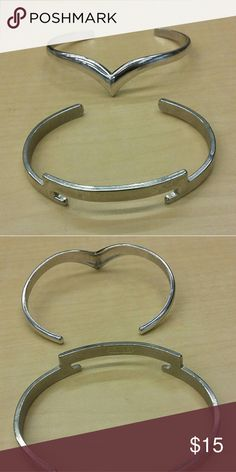 Avon silver metal bangles lot of 2 Two silver bangles by Avon. Geometric designs: one chevron, one bar. Great condition. Can be worn separately or together. Avon mark inside bands. PRICE INCLUDES BOTH BRACELETS! Avon Jewelry Bracelets