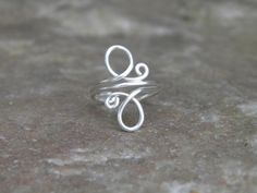 Toe ring... whirls ...sterling silver wire wrapped toe ring.. $10.00, via Etsy.