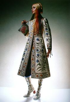 A hand-painted wool crepe coat bordered with flowers from a Persian miniature by Bellville Sassoon. Matching canvas boots by Andrew Whittle and Richard Cawley. Vogue UK November 1970