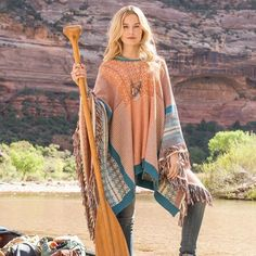 WOMEN'S ALISANDRA PONCHO - A superbly soft knit, fringed poncho to toss on over any outfit for a refined finish.