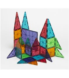 Products - Magna-Tiles® - Standard, Clear Colors, Deluxe (DX) and Working Trucks colorful magnetic tile sets Charlie loves these at school!