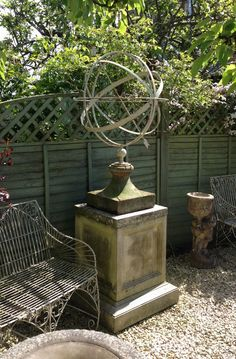 Armillary This antique astronomical device adds interest in the