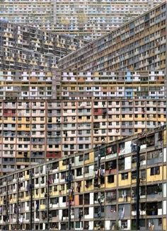 Vertical Slums, Caracas, Venezuela. This home to 4,000 has 45 floors with no working elevator. Many apartments have no glass or walls. People carry heavy water jugs up the stairs. Pres. Hugo Chavez encouraged his followers to live there. The govt in 2014 was moving squatters to safer homes.