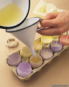 Light up your spring table with a dozen brightly colored eggs doubling as candles. Simple eggcups make a lovely base.