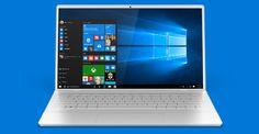 Equipo portátil abierto con la pantalla Inicio de Windows 10