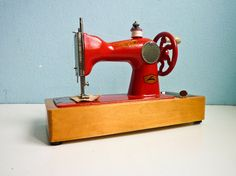 This is actually a vintage toy. http://www.etsy.com/listing/89885670/vintage-sewing-machine-small-toy-working?ref=tre-2071665235-3      http://www.etsy.com/treasury/MTIyMjQyODd8MjA3MTY2NTIzNQ/color-called-red?index=240