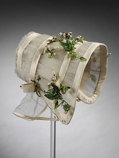 Silk tulle and crêpe wedding bonnet with imitation orange blossoms, British, 1845.  Worn by the mother of the donor, Miss Blanche H. Buckley.