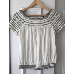 Anthropologie off-the-shoulder Top Deletta white top with navy stitching. Can be worn off the shoulder or regular tee style. TTS Anthropologie Tops Tees - Short Sleeve