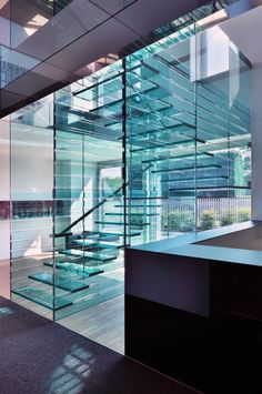 Buratti & Battiston Architects - The all glass stair at the Vetreria Airoldi offices, Milan 2009. The glass treads slide into slits cut of of the double-paned side walls without screws or adhesives.