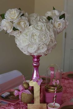 Beautiful rose centerpiece at a pink and gold Minnie Mouse birthday party! See more party ideas at CatchMyParty.com!