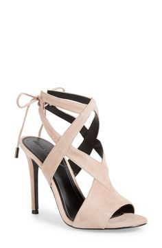 Obsessing over these chic yet edgy sandals lifted by a tall wrapped heel and detailed with sultry ties behind the ankle.