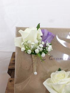Grooms buttonhole made with a white rose, lisianthus and gypsophila. Created by http://www.floristilene.co.nz/