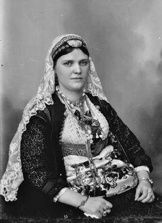 Portrait of an Albanian woman in festive costume.  Early 20th century.  (Studio Marubi, Shkodra).