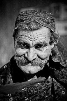 Old guy, elderly male, wrinckles, lines of life, powerful face, intense eyes, wisdom, moustache, portrait, b/w