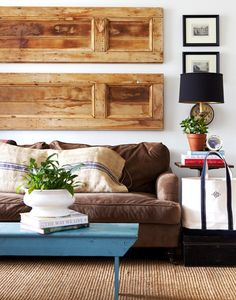 Hang shutters sideways above couch.