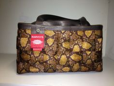 Large satchel..Looks like snake skin..