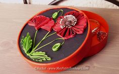 Box decorated by quilled poppies