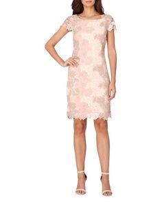 """<ul><li>Delicate lace adds a sweet touch to this elegant, cocktail dress</li><li>Round neckline</li><li>Short sleeves</li><li>Back zip</li><li>Lined</li><li>About 31"""" from shoulder to hem</li><li>Polyester</li><li>Dry clean</li><li>Imported</li><li>This item will arrive with a tag attached and instructions for removal. Once t..."""