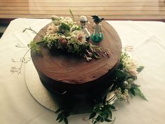 Goku and Chi Chi wedding toppers on Mexican Chocolate cake with Australian native flowers