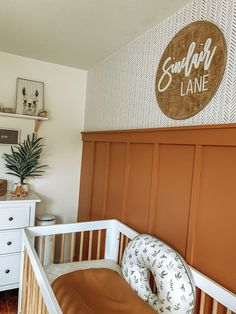 Boho Neutral Nursery in rust and white #nurserydecor #nurseryideas #nursery #babynursery