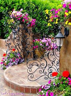 WAW Lovely garden gate :)  I don't think it will stay more than a week in it's place if i gon mad and have one like this in my garden , as I have a grand children from Hill :-/