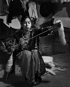 Navajo girl handspinning by John Collier Jr.
