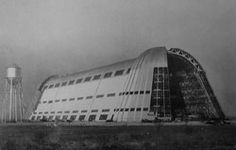 Hangar One is one of the world's largest freestanding structures, covering 8 acres at the Moffett Field Airship hangars site in Mountain View, in Santa Clara County of the southern San Francisco Bay Area, California.  The massive hangar has long been one of the most recognizable landmarks of California's Silicon Valley. An early example of mid-century modern architecture, it was built in the 1930s as a naval airship hangar for the USS Macon.