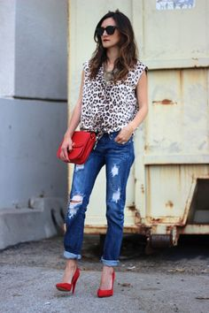 I'm not a fan of leopard print, but I like the style of the shirt with the jeans and heels.