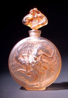 "R. LALIQUE Perfume bottle, ""Rosace Figurines,"" c. 1912, in clear and frosted glass with sepia patina. The rarer, figural stopper version of this model. Bottle and stopper are original with matching control numbers. Engraved R. Lalique. M p. 327, No. 488. 5"""
