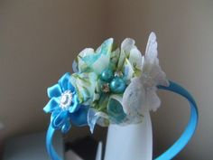 Turquoise Floral Chiffon Flower, a little Satin Flower with a Fiamante centre and a Whte Tulle Sequinned Butterfly.