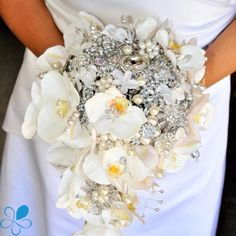 """Brooch Bouquets are a HUGE trend right now! This one has a large quantity of jewels, but also incorporates one of my favorite flowers--Phalaenopsis Orchids. You could choose this Bouquet to compliment a very simple White Dress with little matching Jewelry. OR... channel Beyoncé  by going over the top and literally dripping with diamonds from head to toe! Whoever said """"Less is More"""" is clearly NOT the same person who said """"Diamonds are a Girl's Best Friend"""", right Queen Bey? #olinafloral"""