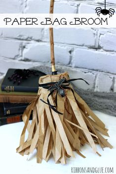 Halloween Paper Bag Broom made from brown paper bags and a popcorn box. Yes, a Popcorn box keeps the broom shape!