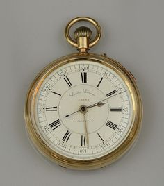 An 18ct gold open face chronograph pocket watch  The white enamel dial with black Roman numerals, centre seconds hand and outer scale 0-300, signed 'Centre Seconds, Chronograph', to an 18ct gold case hallmarked for Chester, 1888, with enamel monogram to reverse and presentation inscription to interior, the ¾ plate movement, case and dial numbered '52543', case diameter 5.2cm, gross weight approximately 135gm.