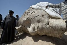 Rare find: Archaeologists also discovered the alabaster head from another Amenhotep III statue