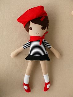 Custom listing for Sara:    This is a handmade cloth doll measuring 19 inches. She is wearing a black and white striped shirt with a short black