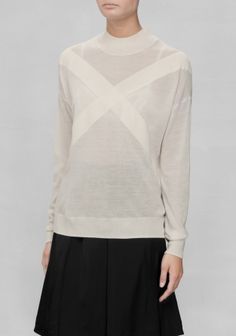 A timeless wool sweater featuring a cross pattern across the chest. http://www.stories.com/nl/Ready-to-wear/Knitwear/Cross_Sweater/582940-7036299.1