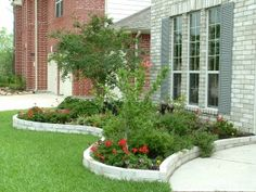 Raised brick garden.  I like how the contrast between grass and garden is accentuated by the brick border.