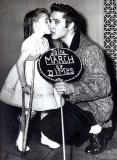 Elvis helped promote polio vaccinations for the March of Dimes (MOD). He was photographed with the organisation's poster girl, Joanne Wilson, and also having his polio vaccination.