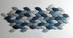 acoustictile — acoustic tiles made from moulded Luffa. The indigo colour is absorbed wastewater from the denim-dyeing industry.