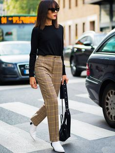Both stirrup pants and white boots are on the streets—it's all to do with the burgeoning eighties fashion trend.