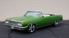 """1964 Chevrolet Chevelle Convertible 327/350 HP, AutomaticFrame-off rotisserie restoration - Rust free car - Dodge Viper Snake Skin Green - 18"""" and 20"""" wheels - Wilwood 4-wheel disc brakes - Tubular control arms front and rear - Front and rear sway bars - Front and rear QA1 adjustable shocks - Aluminum radiator with electric fans - Edelbrock Enduroshine dual carburetors and intake - Air conditioning - Power windows - Digital dash, chrome steering column - Billet Specialties steering wheel"""
