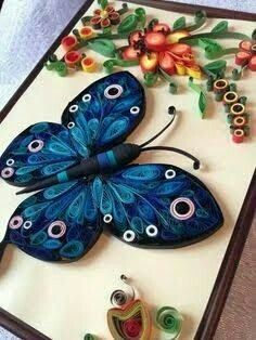 A beautiful quilled blue butterfly flutters among the flowers - quilling Quilling Butterfly, Arte Quilling, Paper Quilling Flowers, Paper Quilling Tutorial, Quilling Work, Paper Quilling Patterns, Origami And Quilling, Quilled Paper Art, Quilling Paper Craft