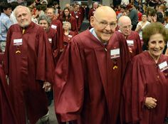 "A ""Long Maroon Line"" of 125 alumni donned maroon robes and processed into Alumni Gym at the opening of Convocation on Oct. 3 as a special tribute to #Elon's 125th anniversary. Read more: http://www.elon.edu/e-net/Article/79469"