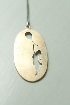 Banksy inspired brass pendant