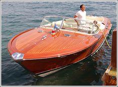 1973 Italian Riva Aquarama wooden speed boat by the dock.